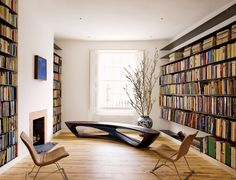 Architect Amanda Levete decorated her family home library in London with a pair of 1955 Gerardo Clusellas chairs, a Drift bench she designed herself, and an abstract painting by Brian Clarke.Photographed by Simon Upton, Vogue, May 2011