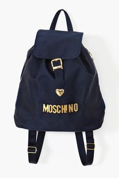 "Moschino. Heart. Black Backpack with Gold Charms. So many elements I loved about Moschino. Black. Gold. Hearts. ""Cheap and Chic"" concept. (although they lied about the ""Cheap"" part.) While I never really fell in love with luxury brands, Moschino was one of the exceptions that I adored... when I was a kid."