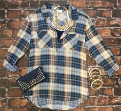 Take Me Home Plaid Top: Blue/Rust can be worn as long sleeves or a 3/4 top. It…