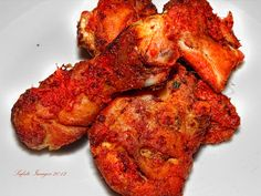 Tandoori chicken is a popular Indian dish consisting of roasted chicken prepared with yogurt and spices