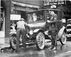 Police officer issuing ticket to driver of Model T Ford, 1922. :: R. G. Potter Collection