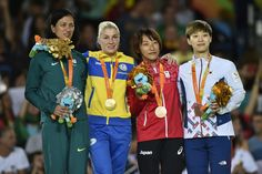 (L to R) Silver medalist Lucia da Silva Teixeira Araujo of Brazil, gold medalist Inna Cherniak of Ukraine, bronze medalists Junko Hirose of Japan and Hana Seo of Korea celebrate on the podium at the medal ceremony for the Women - 57 kg Judo during day 2 of the Rio 2016 Paralympic Games at the Carioca Arena 3 on September 7, 2016 in Rio de Janeiro, Brazil.