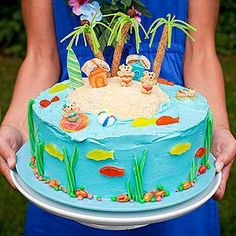 Summer cake. Rocks are jelly beans, bears are gummy bears, lifeguards ring are lifesavers. Sand is brown sugar!