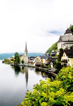 A postcard-perfect photo of Hallstatt, Austria's most beautiful town. Click through for a comprehensive Hallstatt travel guide.