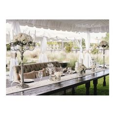Bride and Groom's table - using a beautiful settee from our specialty rentals added a softness to the head table while offering the special couple comfortable seating to enjoy the celebration.  Pillows custom made in matching Cameo Tori fabric used on bistro tables
