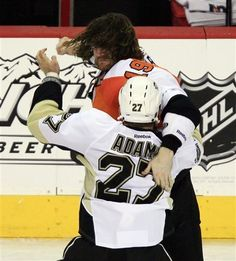 Scott Hartnell hits Pittsburgh Penguins Craig Adams, during the third game of the series against the Flyers. (AP Photo / Tom Mihalek)