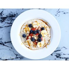 Almond Milk Porridge w/ Banana & Berries, Flaked Almond, Chia Seeds and topped w/ Coconut Blossom Syrup | WeEatWhat