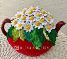 A personal favorite from my Etsy shop https://www.etsy.com/listing/533075125/crochet-tea-cozy-red-tea-cover-daisy-tea