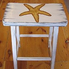Painted Stool with Starfish by artist Eileen Whalen.