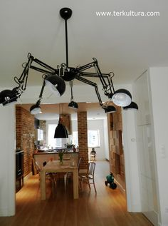 """Ou comment transformer 8 lampes de bureau IKEA en plafonnier """"araignée"""" /Budapest designer Petra Nikoletti bought eight Ikea Forsa lamps and a salad bowl and had a locksmith precision fit them into a """"spider lamp"""" Ikea Lighting, Cool Lighting, Task Lighting, Lighting Ideas, Ikea Forsa Lamp, Ikea Hacks, Spider Lamp, Anglepoise Lamp, Diy Chandelier"""