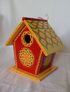 Scarlet Red and Yellow Painted Birdhouse with Floral Designs Rope Attached. $35.00, via Etsy.
