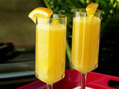 Pineapple Orange Mimosas!! Looks yummy! My recipe: 1 bottle of Brut Andre Champagne 1 bottle Ginger Ale (optional) 1bottle OJ  Pineapple juice.