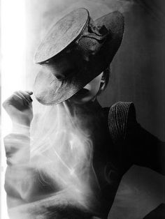 Directional light from behind w/smoke...arty black and white...  Smoke...Love the composition of this image. x