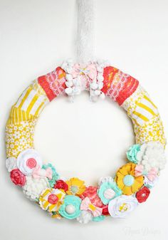 Bright and Fun Spring Wreath #spring #wreath #fabric #diy #yellow #lace #ribbon #fabricflowers #sheblogs #missionpossible