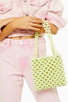 Shop this seasons must have bags and purses at TOPSHOP. Find clutch bags, shoulder bags, purses and luggage wear to suit you in It Bag, Latest Bags, Striped Bags, Ideias Diy, Metallic Pink, Beaded Bags, Beaded Jewelry, Grab Bags, Seed Beads
