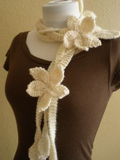 Knitting: Flowers on a vine scarf -- I kinda like this! I don't think I could pull it off at work though lol