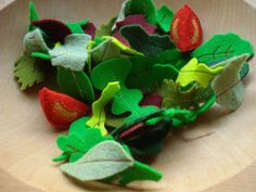 "Mixed Baby Greens Salad - Ten to twelve hand-cut leaves are cleverly sewn together into a 'handful' of salad for easy clean up. Tomato wedges are about 1.5"" long.    Includes 4 machine-sewn 'handfuls' and 2 hand-sewn tomato wedges."