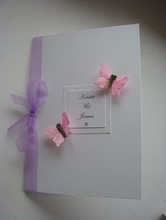 Wedding order of service or menu with feather butterlies and organza ribbon. Shown in pink and lilac purple