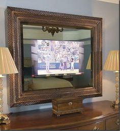 Double Vision Mirror mounts right over your (up to flat panel TV. When the television is on, the picture comes through the two-way mirror crystal clear. Turned off, it's a mirror only My husband will kill me but I love the idea Two Way Mirror, Mirror Tv, Mirror Glass, Double Mirror, Corner Tv Mount, Mount Tv, Tv Covers, Hidden Tv, Ideas