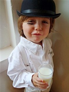 Awww!  Teeniest sociopath ever. — How do you explain to the kid what you've dressed him up as? I am at a loss here...