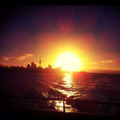 Auckland City sunset as seen from Devonport Ferry (New Zealand)