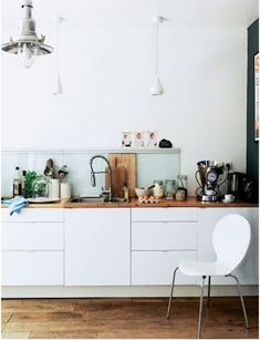 Love the lamp. One day, when remodelling the kitchen could have white cupboards and wooden benches.