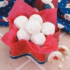"""Cherry Snowball Cookies Recipe -""""These simple cookies have a delicate buttery flavor complemented by the cherry surprise in the center,"""" notes Joy Schuster of Glentana, Montana. """"They've become a holiday favorite for my family."""""""
