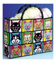 TOBIN-Cat Tote Bag Plastic Canvas Kit. This kit offers hours of endless fun and is perfect for a cat lover. This package contains 7 count plastic canvas, acrylic yarn, trims, handles, fabric for linin