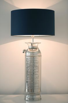 Fire Extinguisher Lamp- Dad made one for our house and I want one when I grow up and get my own house.