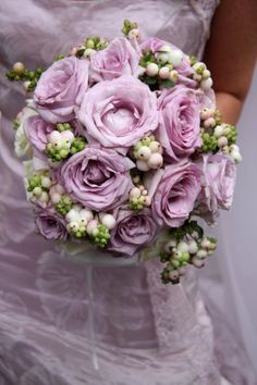 Gorgeous summer bouquet with purple lisianthus and snowberries.