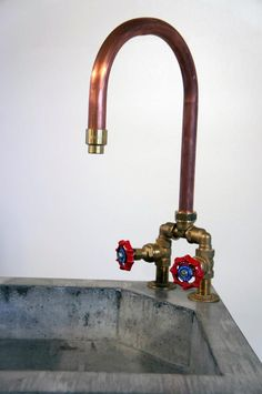 Concrete sink with copper tap by www.janjongejans.nl I love the industrial feel! This would be awesome in a home bar setup.
