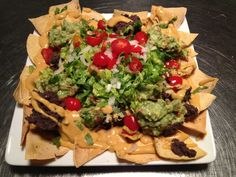 Loaded Nachos Recipe - Protective Diet This is a compilation of my all-time favorite party recipes piled up on my all-time favorite food…Baked Tortilla Chips. Most people have a hard time believing this indulgently beautiful spread of nachos is a Protective Diet option. Recipes like Loaded Nachos are what keep us on track and achieving all our health goals. (Affiliate)