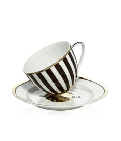 HENRI BENDEL TEA CUP & SAUCER SET  One cup of holiday cheer coming right up. Serve your favorite blend in the gold-foiled bone china Henri Bendel Cup & Saucer Set. Pair with the matching Brown & White Striped Teapot for a heartwarming hostess gift.  $58.00