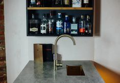 A bespoke bar designed and crafted by Temper Studio for a private residence. An awkward corner of the main living space presented an opportunity to design something completely bespoke and gather to… Choppy Water, Wall Mounted Shelves, Polished Concrete, Studio, Cupboard, Living Spaces, Sink, Bar, Furniture