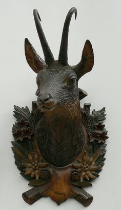 antique black forest carved wood chamois head on a carved wood edelweiss plaque