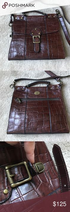 Vintage revival fossil!! Vintage revival fossil croc cross body! This is one of the nags from the most iconic line of fossil bags! Their is something about the way they brought these style purses to life! Has a handle with a detachable long strap. Zipper pocket in the back side. And two pockets on the inside: this bag is in perfect condition!! You will love it!!! Fossil Bags Satchels