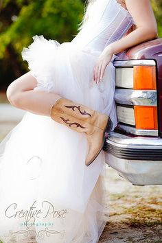 cowgirl boots with wedding dress. love this idea as a pose for a real country girl on her wedding day