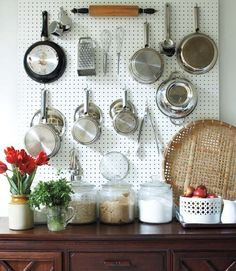 pegboard on your kitchen walls, to hang up your pots and pans