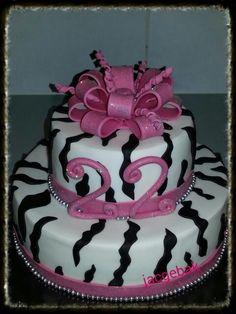 A zebra cake with a bog pink bow ************** Zebra taart met een grote roze strik