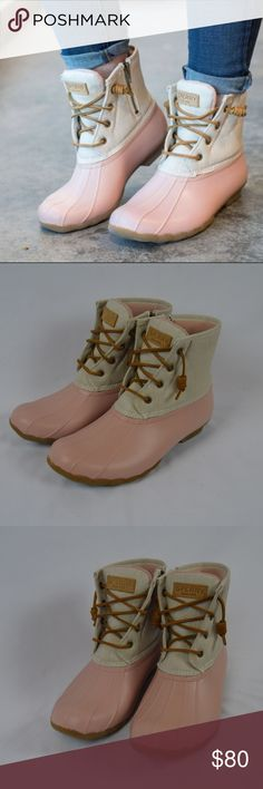 Sperry saltwater rain duck boots Pink 9 1/2 Sperry rain duck boots in excellent condition. Minimal signs of wear on soles. Light pink bottom with a light color canvas shaft. Inside is a light pink warm fleece lining. Waterproof soles for better traction. Any questions feel free to ask. Size 9 1/2. Still on there online store, SOLD OUT in this size. Hard to find. Sperry Shoes Winter & Rain Boots
