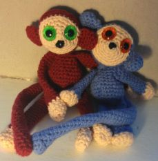 Crochet a monkey with magnets in its hands and feet. Check my website www.hobsies.weebly.com or https://www.facebook.com/HobsiesHaaksels?ref=hl