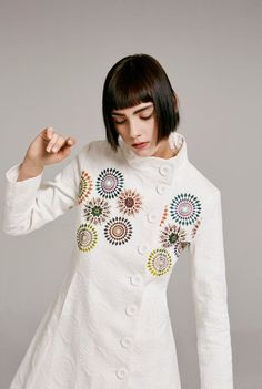 This white coat with mandala details is a show stopper! Find it in Desigual's SS16 Spring collection.