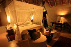Ol Donyo, romantic room, love the orientals, the ceiling, the rich rugs adding a punch to the neutrals. Located in the foothills of the Chyulu Hills, Kenya