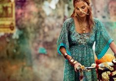 aqua turquoise dress; bangles, ethnic necklace, flowers on bike