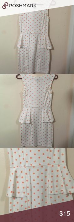 Pink and White Polka Dotted Peplum Dress This dress is a wonderful asset to any closet. It is a polka dotted pattern peplum dress. I originally bought it for $20 and have only worn it 3 or 4 times, therefore it is in great condition. It is a body con like dress. Please feel green to make me an offer! Rue 21 Dresses Midi