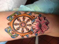 Dharmachakra tattoo