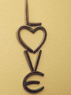 Horse shoe Love wall art.  by FabricationsByBruce on Etsy