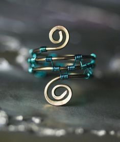 Aqua and Gunmetal Wirewrapped Copper Spiral Ring by Moss & Mist Jewelry, via Flickr