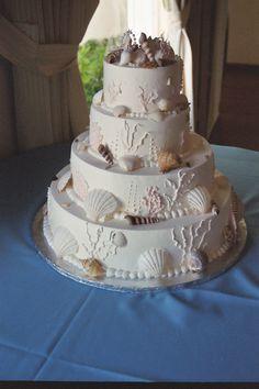 Google Image Result for http://4.bp.blogspot.com/-AOmajIffpMQ/TWVk1zNN_dI/AAAAAAAAAHU/3vWQ9OYj9ao/s1600/Ocean_Shell_Theme_Wedding_CakeBEST.jpg