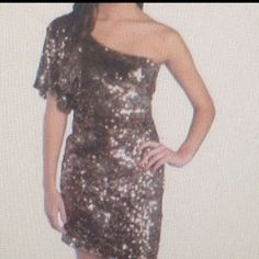 Sequined gold dress One sleeved sequined gold dress. Very cute. Worn once. Excellent condition! Deb Dresses